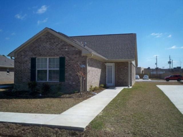 Fullerton Estates, Baton Rouge, LA home tan color and sidwalk