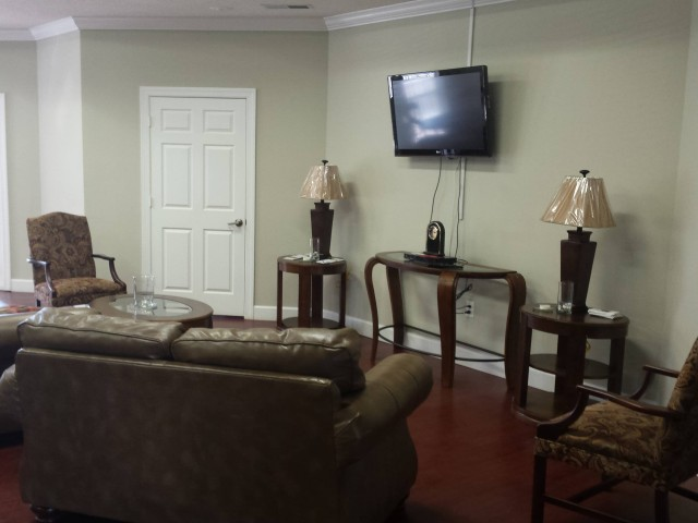 Magnolia Senior, Selma, AL, community room comfortable seating and television