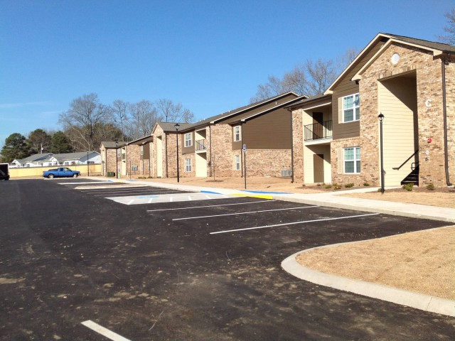 Marshall Gardens, Milan, TN, apartment buildings and parking lot long view left