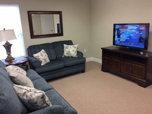 Marshall Gardens, Milan, TN, community building comfortable seating and television