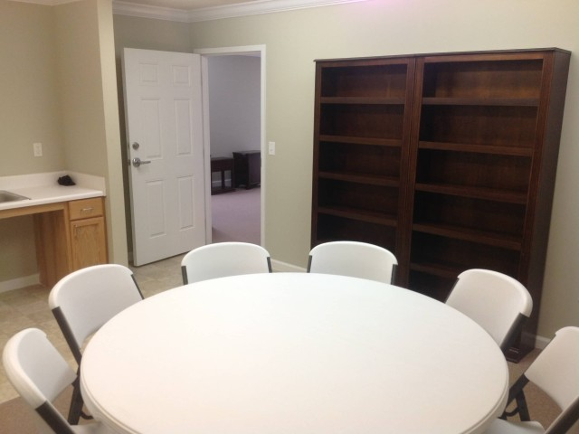 Woodland Village II, Lafayette, GA inside community room table and chairs