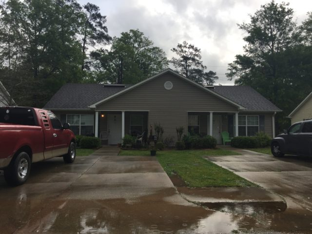 Woodland Commons, Hammond, LA, front brown duplex and driveway