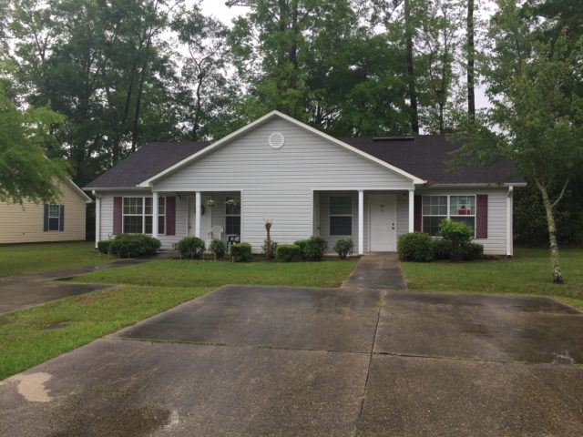 Woodland Commons, Hammond, LA, front gray groomed bushes duplex and driveway