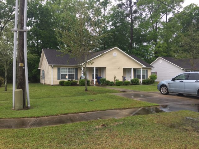 Woodland Commons, Hammond, LA, front yellow with car duplex and driveway